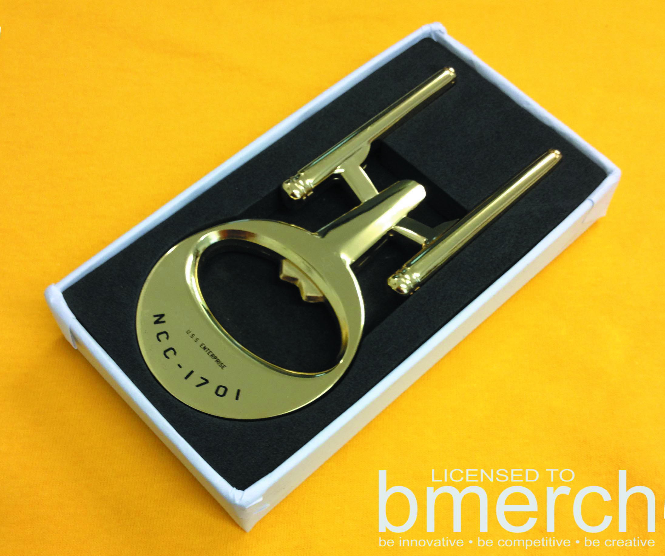 STAR TREK USS ENTERPRISE GOLD BOTTLE OPENER
